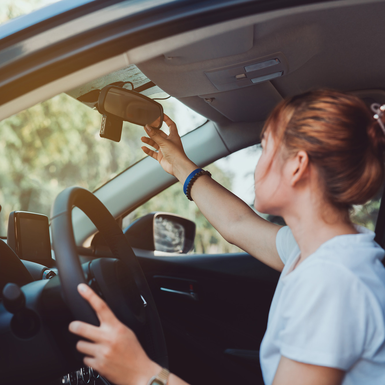 Person checking their rear view mirror.